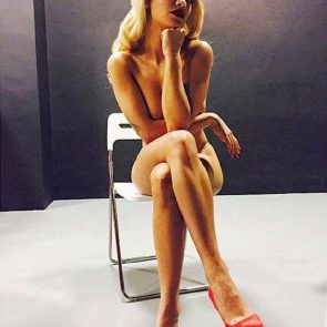 Rita Ora naked sitting on chair