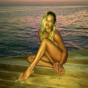 Rita Ora naked by the sea