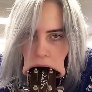 Billie Eilish sucking the guitar