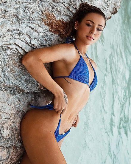 Charly Jordan lying in blue bikini