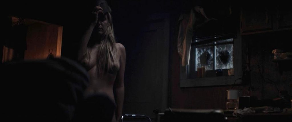 Riley Keough naked in Hold the Dark